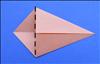 קפלו את הפינה השמאלית לאורך הקצוות של שני הקיפולים.
